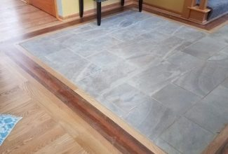 The flooring on this floor was a mix of tile, wood and carpet. The floors were redone to carry through the rooms.