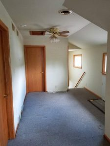 Before of the upstairs hallway of the East Troy remodel.