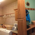 A before and after of a laundry room turned into a mud room.